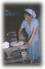 woman shaping dough in Mexico
