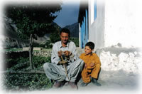 man and child in Shimshal, Pakistan