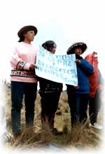 group of Peruvians holding up placard